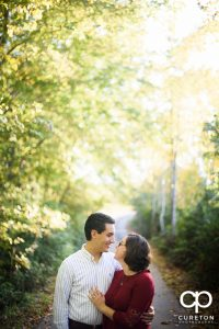 Engaged couple standing in beautiful light.