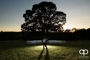 Engaged couple near the tree at Greenbrier farms.