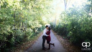 Couple kissing during their engagement session.