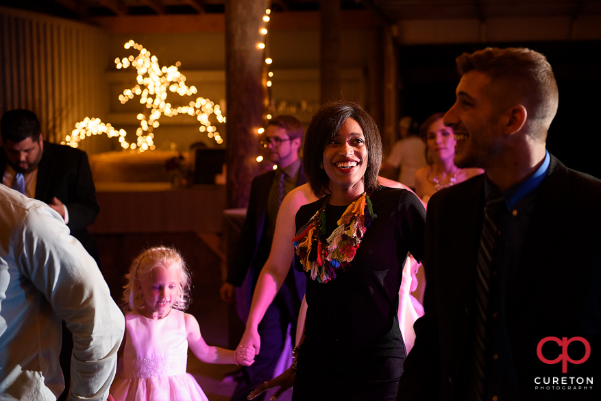 Guests dancing the night away as Uptown Entertainment plays music.