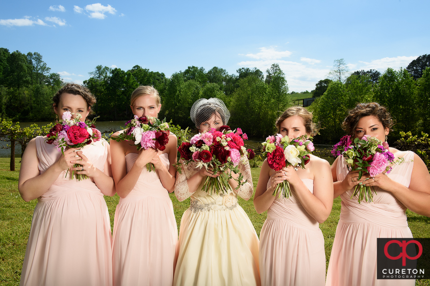 Bridesmaid's holding flowers.