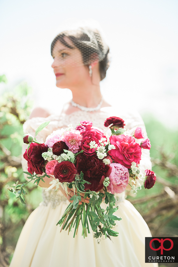 Epic shot of the bride and her flowers.