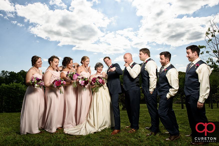 Wedding party looking at the ring.