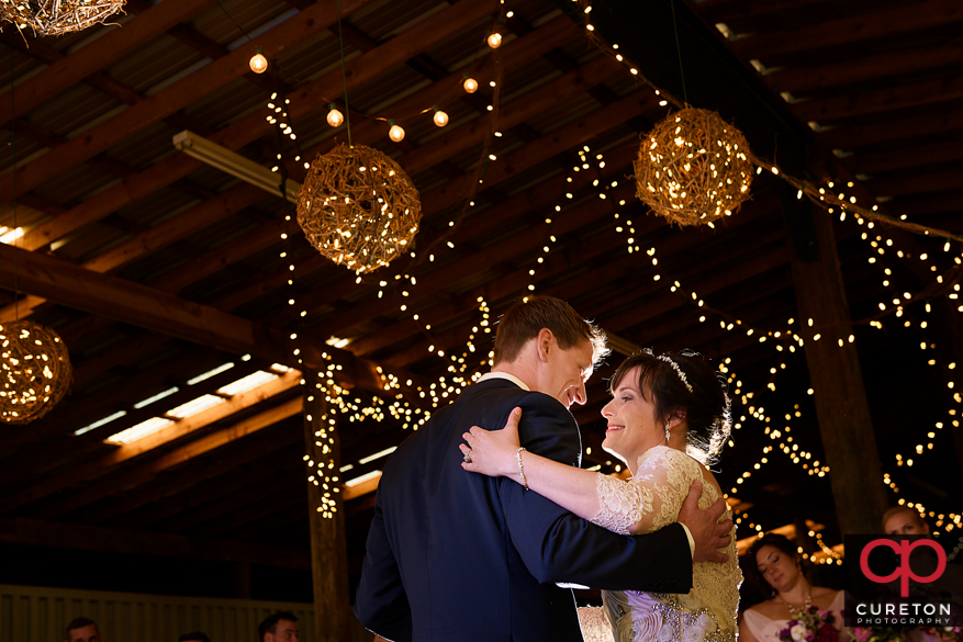 Bride and groom sharing a first dance.