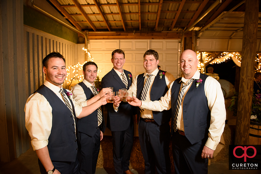 The groomsmen toasting.