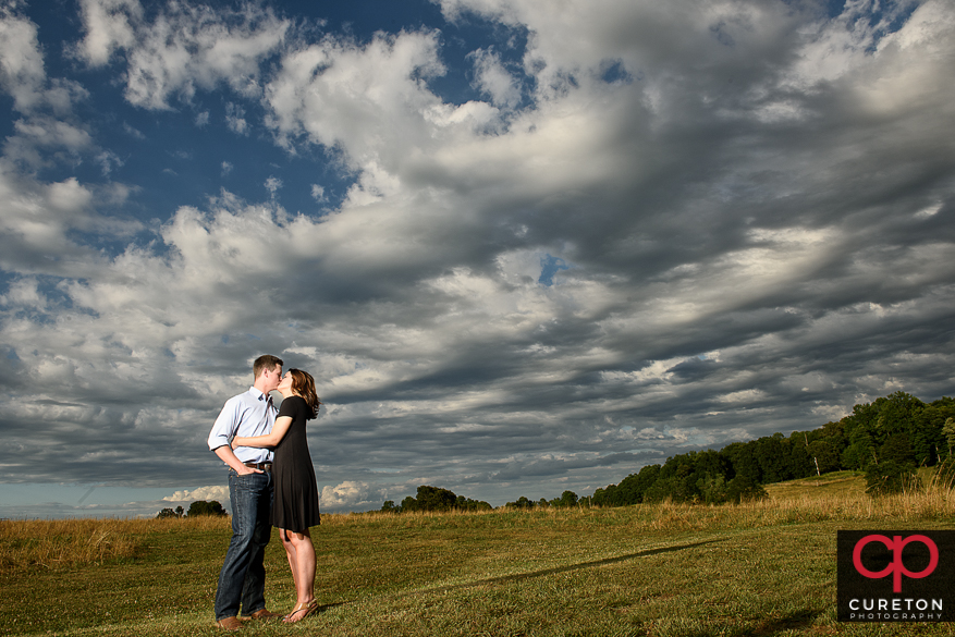 Epic engagement photo at Greenbrier Farms in teh field.