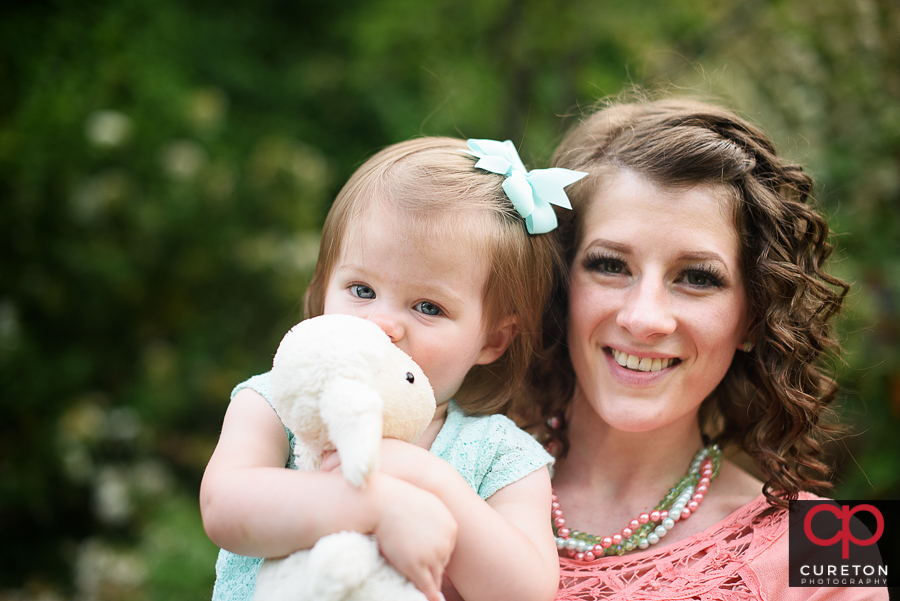 Mom and daughter during a family photo session at the Rock Quarry Garden in Greenville,SC.