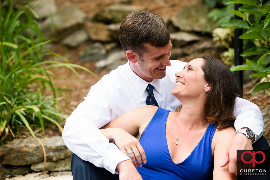 Engaged couple looking at each other during a Greenville park engagement session.