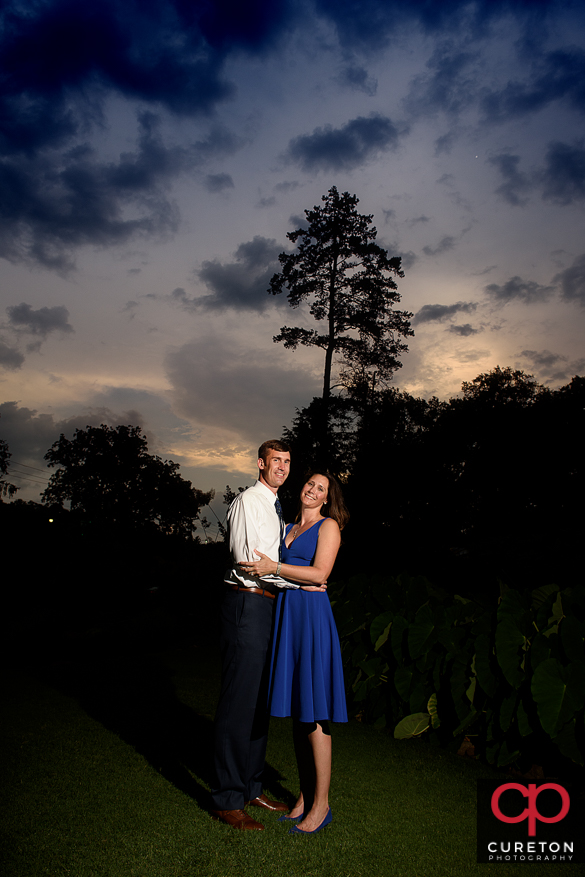 Couple holding each other at sunset during their engagement session in Greenville,SC.