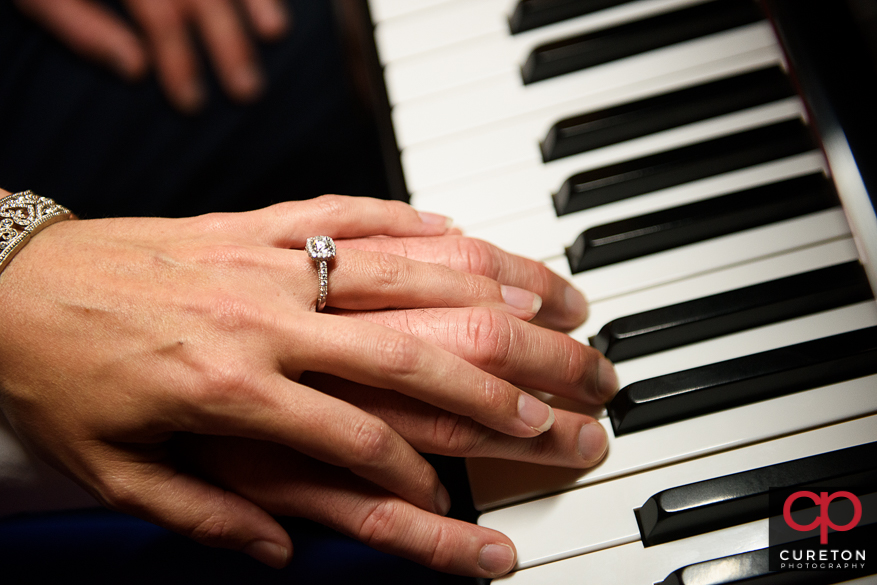 Engagement ring on the keys of a piano.