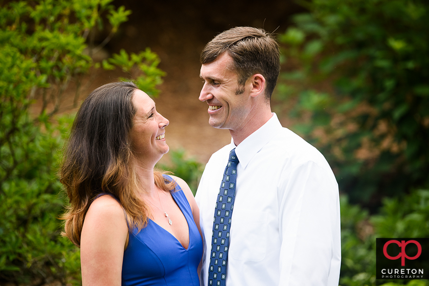 Engaged couple having fun in a downtown Greenville,SC park.