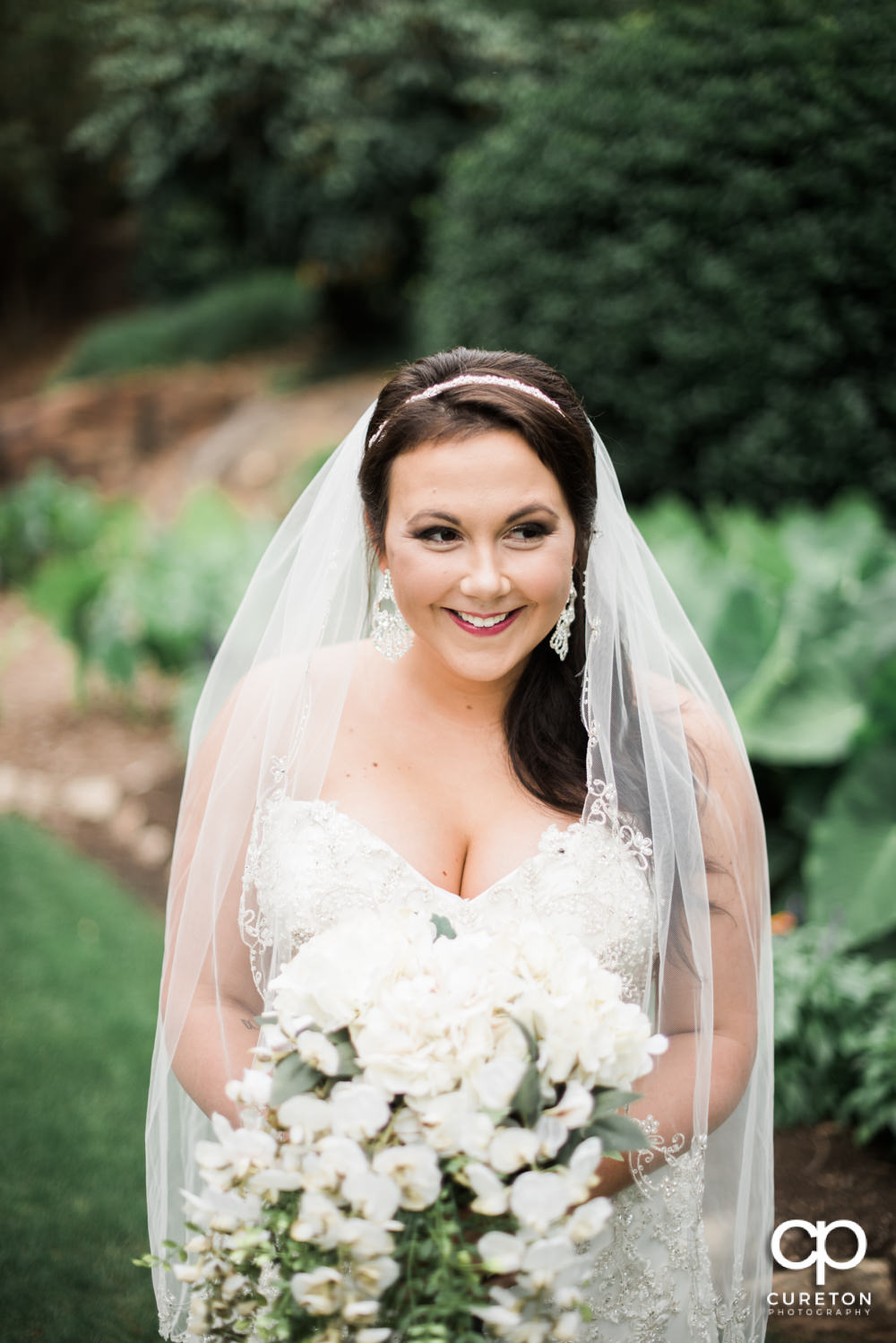 Bride laughing during her bridal session at the Greenville Rock Quarry Garden.