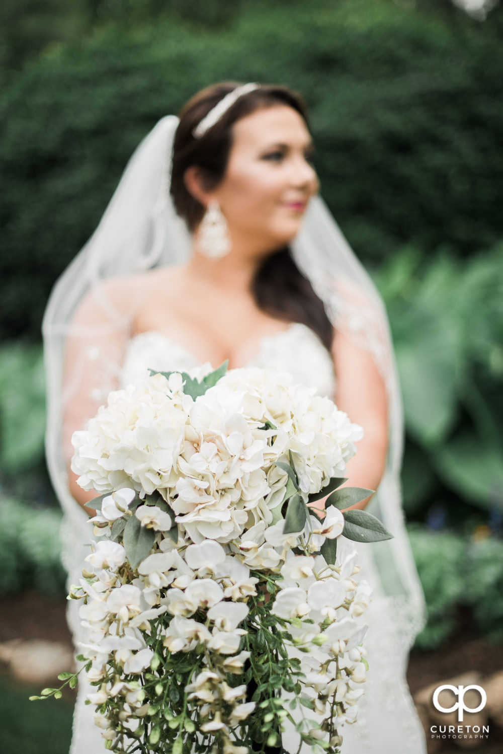 Bride holding her bouquet out.