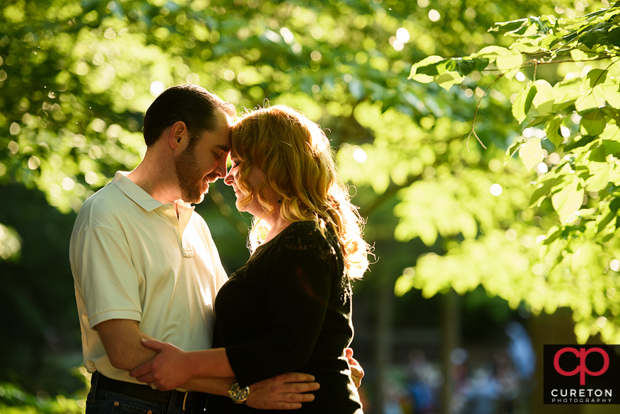 A future bride and groom at an greenville sc downtown engagement session.