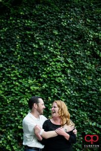 A future bride and groom at an greenville sc downtown engagement session in falls park.
