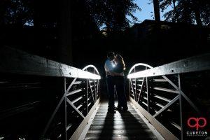 Engaged couple on the bridge at Falls Park.