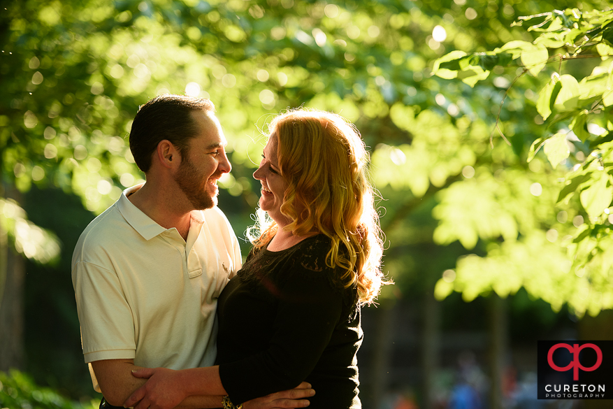 Enaged couple standing in beautiful light.