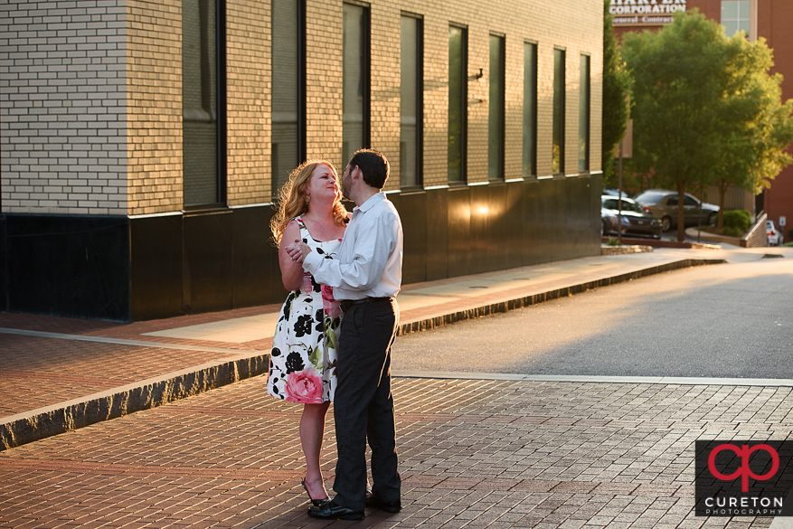 Couple dancing by the Westin Poinsett in downtown Greenville, SC.