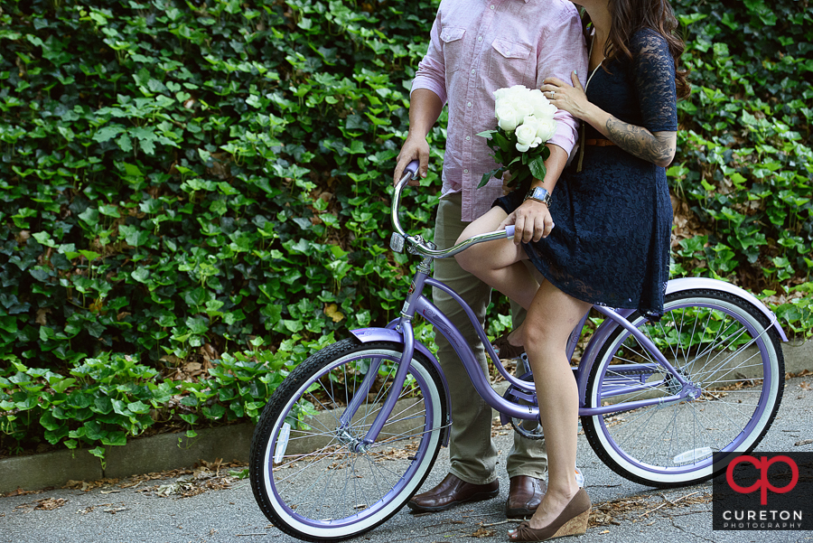 Couple on a vintage bicycle during a Greenville,SC engagement session.