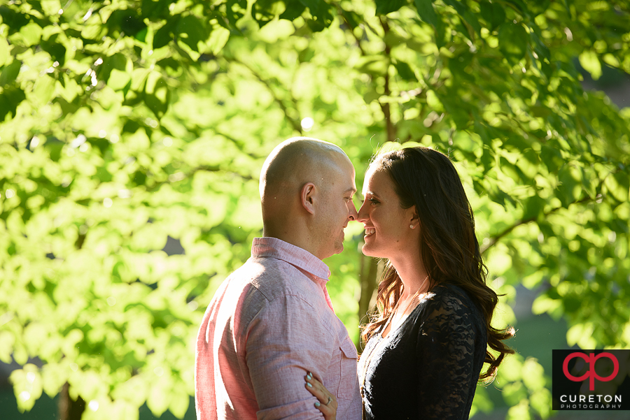 Couple standing in great light in during a downtown Greenville,SC engagement session.
