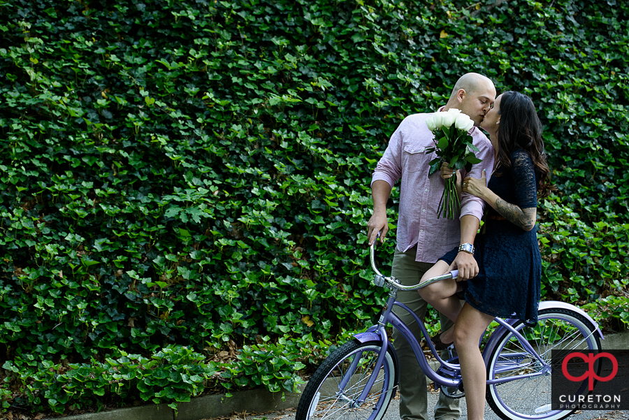 Engaged couple on a vintage bicycle in downtown Greenville,SC.