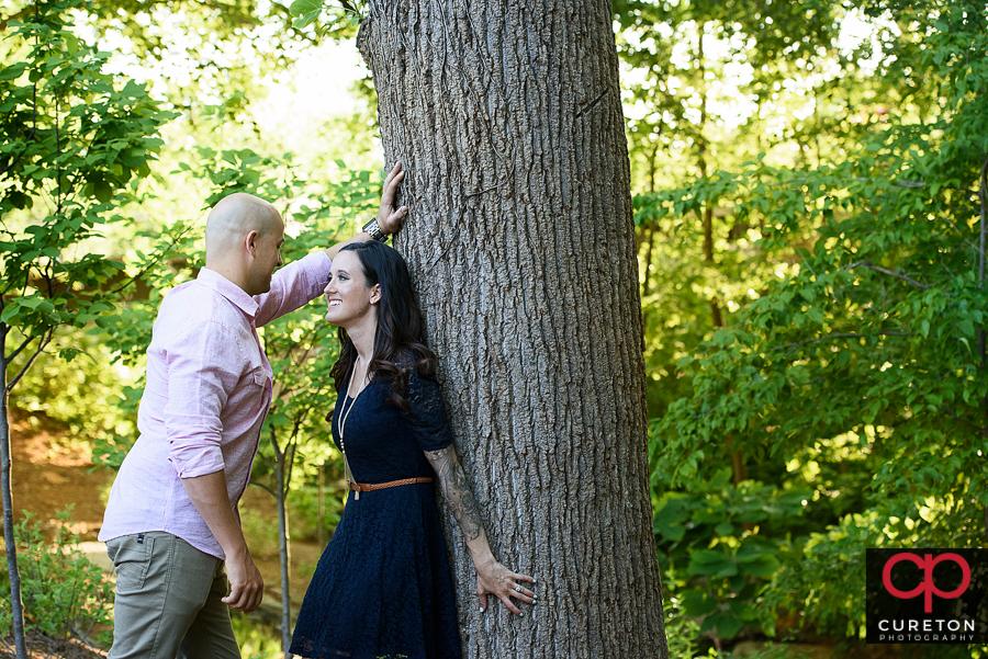 Couple near a tree in falls park.