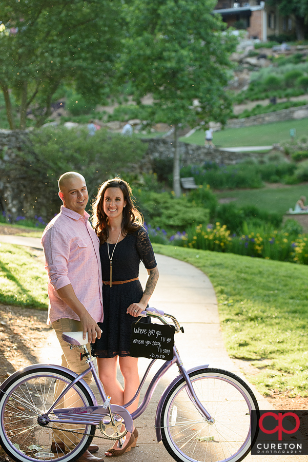 Couple in downtown Greenville with a bicycle.