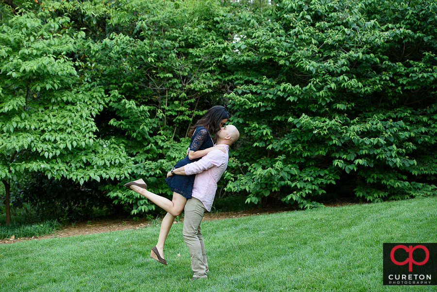 Couple dancing in the park.