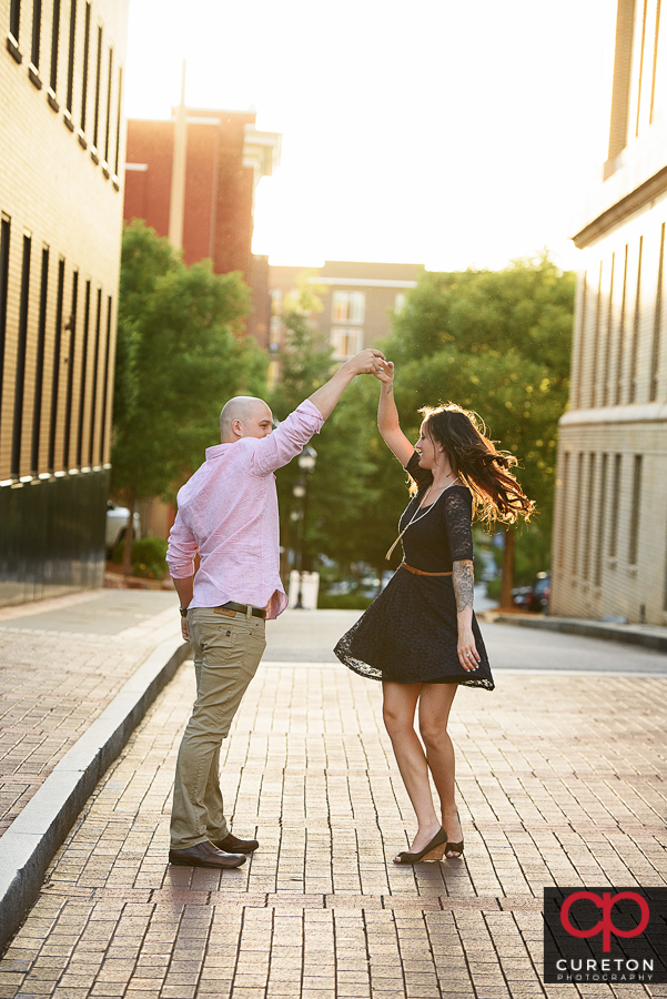Couple dancing in downtown Greenville,SC.