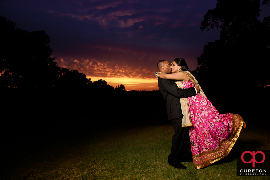 Indian bride and groom during sunset at Embassy Suites in Greenville,SC after an Indian wedding.