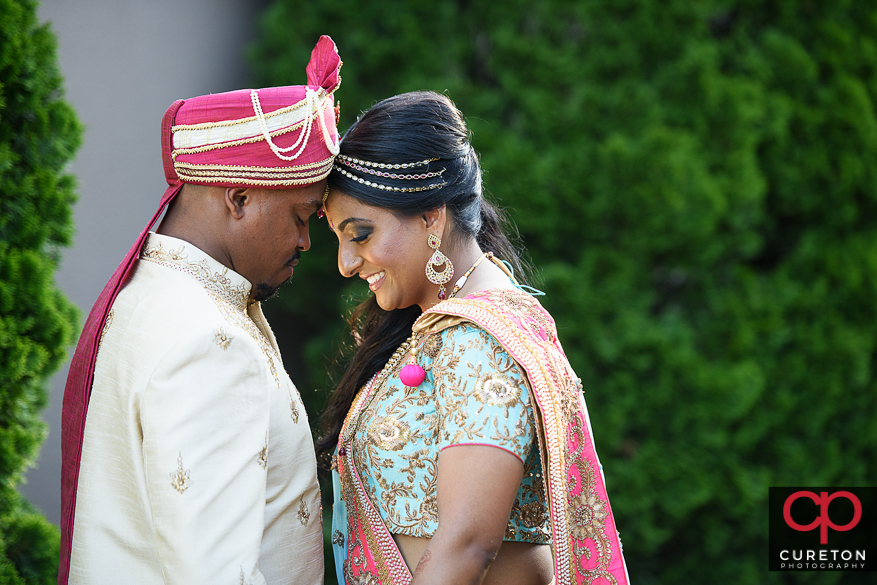 Indian bride and groom during a pre-wedding first look.