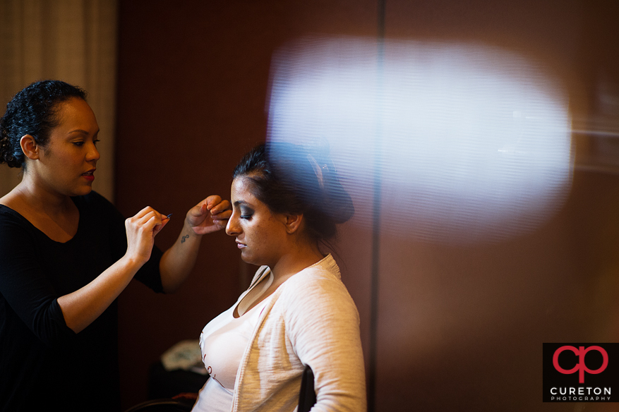 Bride getting her makeup applied by Latia from Cotton Rouge and Co.