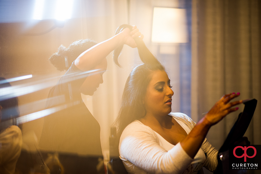 Bride getting her hair done by Cotton Rouge and Co.
