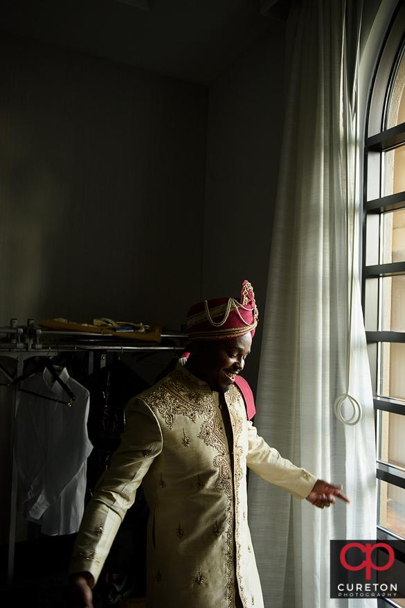 Indian groom in window light.