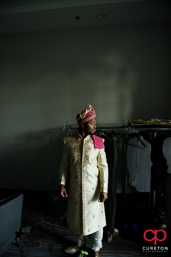 Groom in traditional indian wedding clothes.