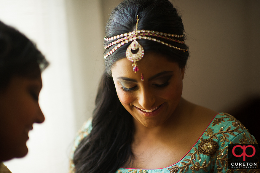 Indian bride getting ready.
