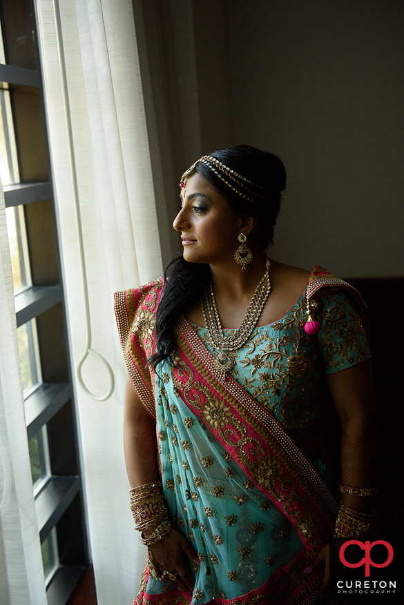 Indian bride staring out of the window.