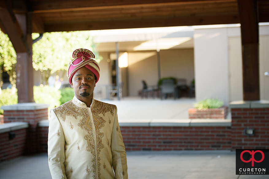 Indian groom awaiting his bride before their first look.