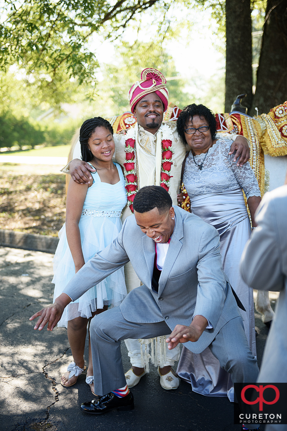Groom hanging out with his family before his wedding.
