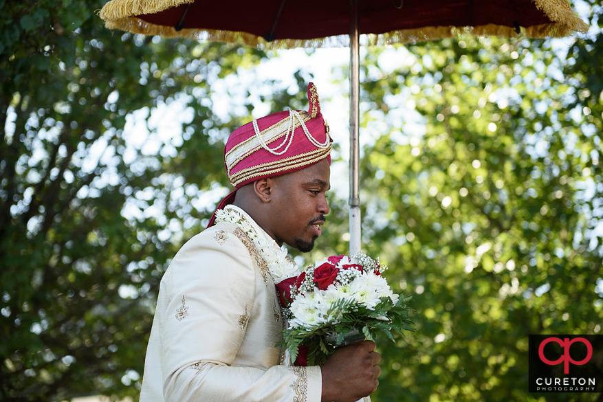 Groom on a horse for the Baarat.