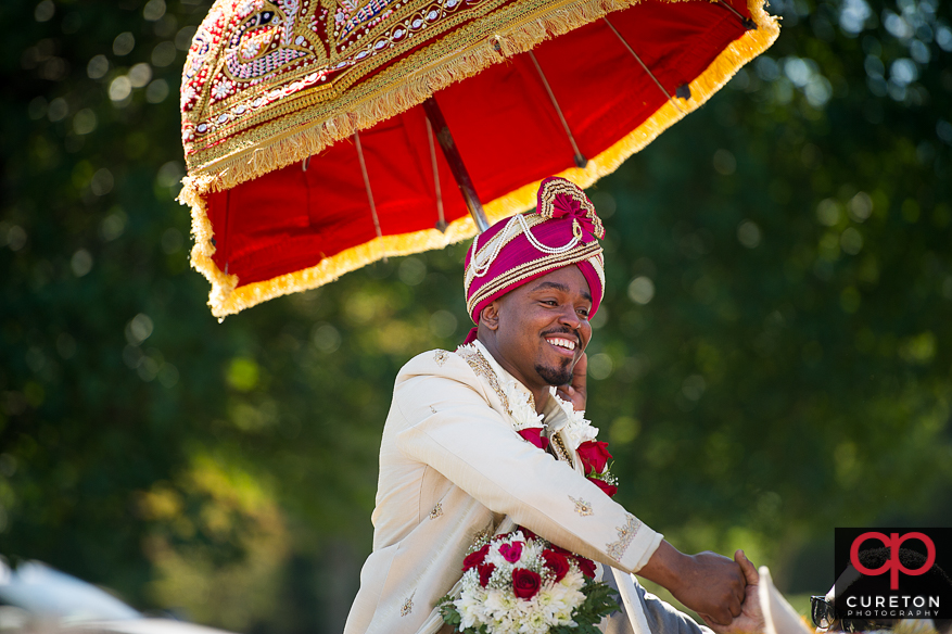 Groom on a horse during the Baraat.