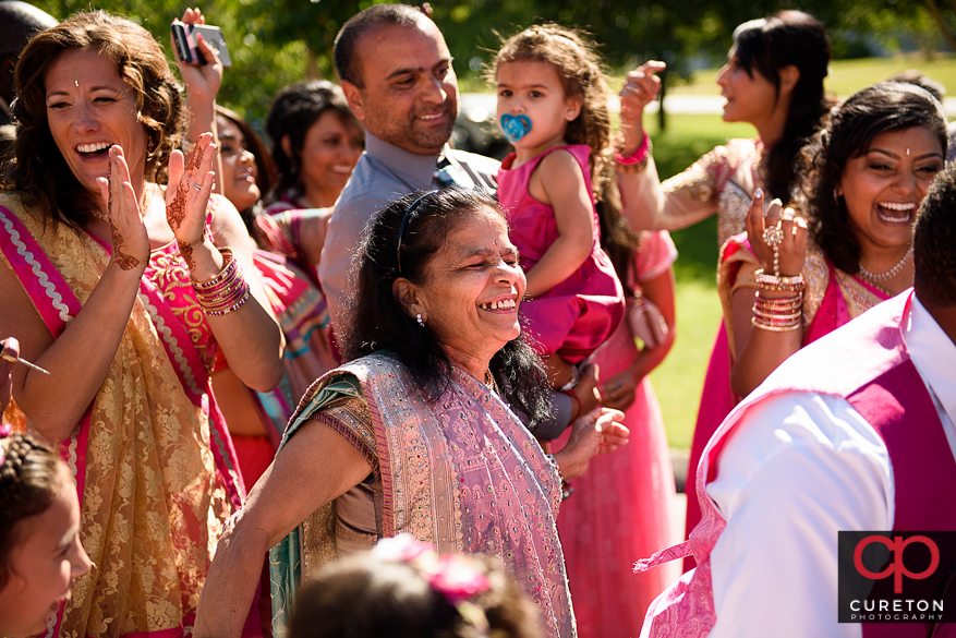 The bride and groom's families dancing during the Baraat before the Indian wedding in Greenville,SC.