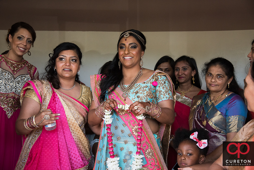 The bride greets the groom before the Indian wedding.