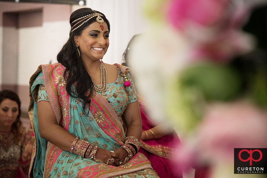 Indian bride smiling during her wedding.