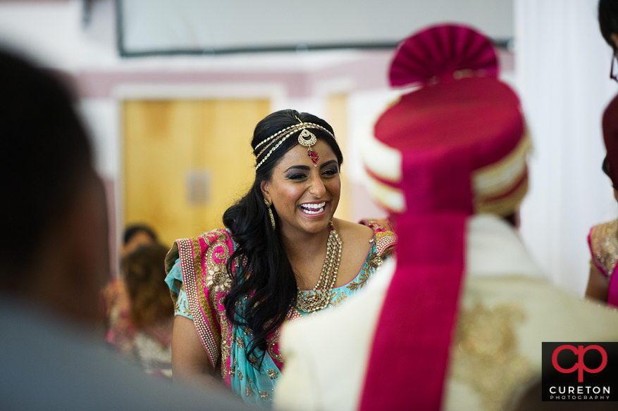 Indian bride laughing during her wedding ceremony.
