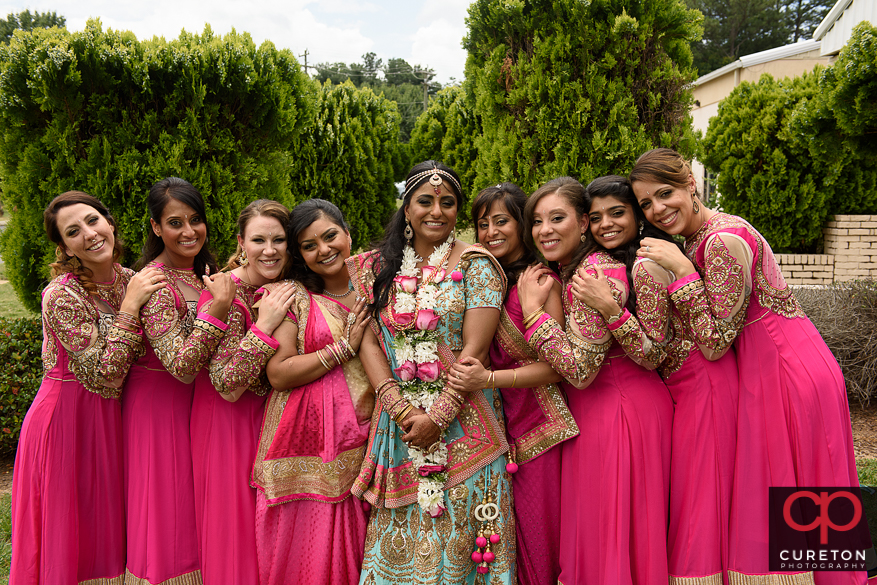 Colorful Indian bride and her bridesmaids.