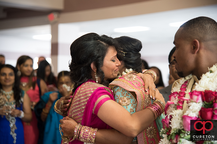 Bride and groom leaving their Indian wedding.