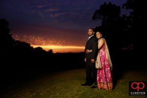 Indian Bride and Groom at sunset after their wedding.