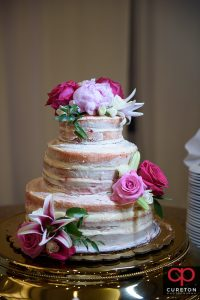 Wedding cake with with flowers.