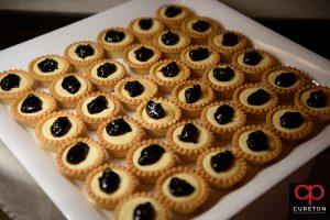 Mini tarts on the desert bar.
